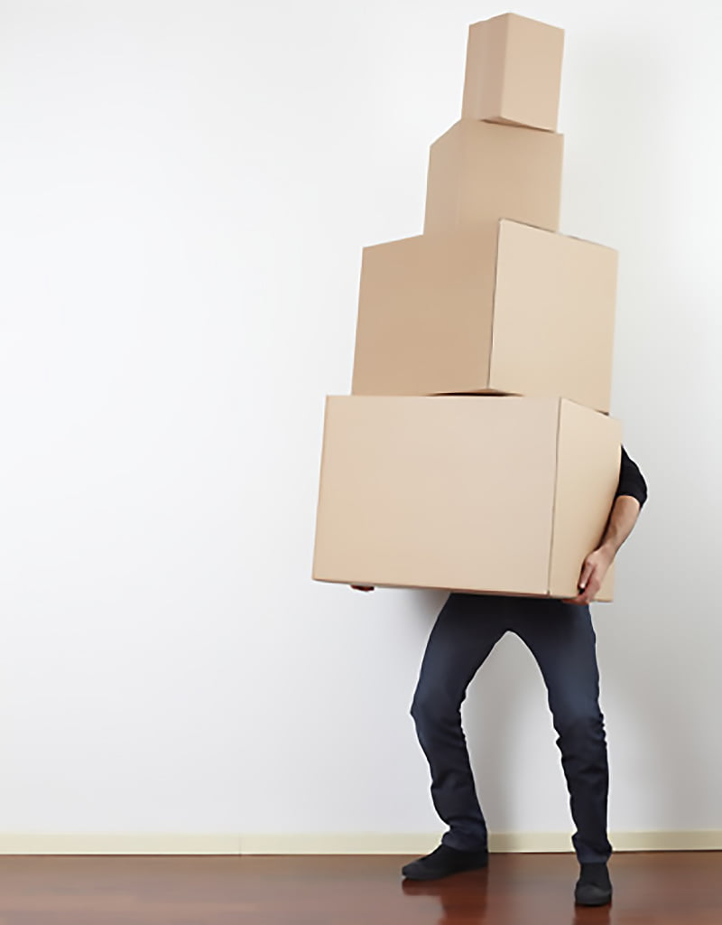man-lifting-cardboard-boxes-in-apartment-moving-day-800